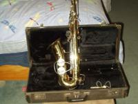 This is an old Buescher Aristocrat Alto saxophone that