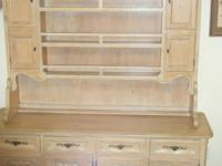 Beautiful two piece buffet hutch made of solid oak.