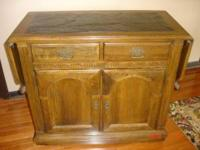 Ethan & Allen buffet table on rollers. Has end has a