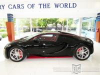 This 2012 Bugatti Veyron Grand Sport features a 8.0