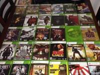 We have 31 Xbox 360 games with microphone & guitar