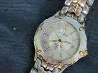 Silver with Gold band. Bulova MAN'S Watch with metal