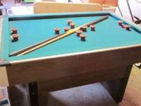 Bumper Pool Table with balls and sticks in good