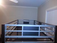 Bunk bed with a futon on the bottom. call or text,