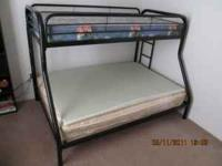 All metal bunk bed. Full on bottom, twin on top.