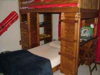 Solid wood bunk bed with desk, drawers, and chest. This