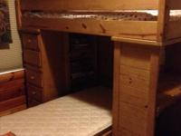 Wood bunk beds.  Desk on one side shelving and drawers