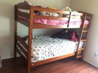 Cherry colored wooden twin bunk beds with side railing