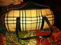 Real Burberry I guess? Has number T-04-01 on it. Bought