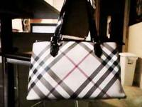 I am selling a Burberry Supernova tote hand bag. Retail