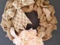 This beautiful burlap wreath has lace accent ribbon and