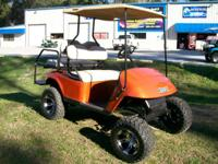 2009 EZ-GO PDS Burnt Orange colored Golf Cart. This is