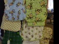 Burp clothes made of a diaper on one side and flannel