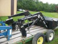 Like New BUSH HOG 2425QT loader with joystick control.