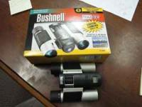 Brand new still in box Bussnell binoculars with buith