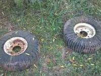 I HAVE 2 BUSH-HOG WHEELS AND SOLID TIRES THEY ARE IN