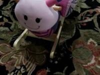 This Beautiful Butterfly Musical Plush Rocker prepares
