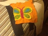 orange t-shirt with 3d butterfly formed by ruffles -