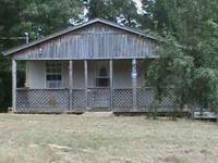 2 bedroom, 1 half bath,2 story cabin with wraparound