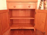 Solid wood cabinet in great condition. Nicely
