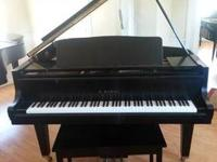 This is a beautiful Cable Nelson Console piano gold oak