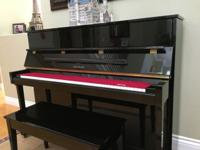 Cable-Nelson high gloss ebony upright piano was