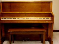 Cable upright console piano with bench. In good working