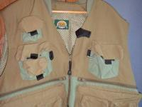 Cabela's fly fishing vest.  Like new condition.  Size
