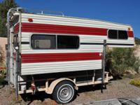 This nice cabover camper is set up and ready to go.  It