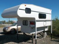 2005 Cache Camper for sale. Fits a long bed truck. In