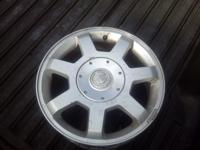 stock 17 inch Cadillac rims contact Larry at Auto