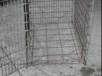 Large metal cage with door on one side  stephanie text