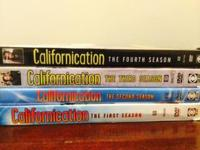 Un-scratched DVDs of Californication Seasons 1-4. Text