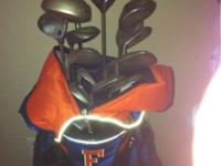 Set of callaway and cobra golf clubs with university of