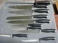 Selling this Calphalon knife set, it originally cost