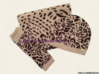 Look fierce with this shimmery leopard print hat, scarf
