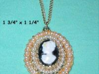 "This vintage Cameo necklace is 9"" long when closed. The"