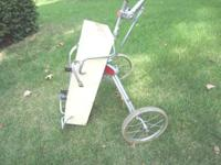 Folding two wheeled Ajay 910 golf pull cart with cam