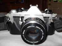 This vintage 35mm Pentax Camera, comes with 3 lenses,