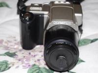 I am selling an Olympus Camedia C-2500L DSLR Camera