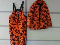 Jacket is a large, bibs are extra large. Removable hood