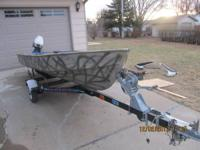 camo duck hunting/fishing boat, has a low hrs 4 stroke