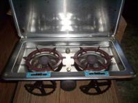 This is a two cooking eyes boating or camp stove, sold