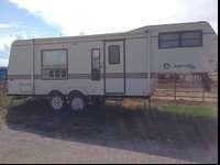 Jayco, 5th wheel, 27 ft camp trailer, 1987. This