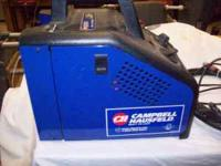 This welder is about 3 years old. It uses flux core and