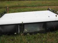 Selling this white Long bed camper shell. It is in good