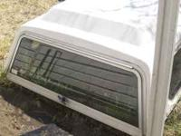 clean white camper shell for smaller trucks. was on a