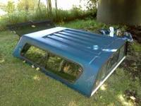I have a nice fiberglass camper shell that fits onto a