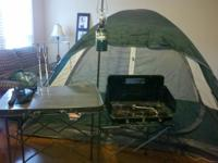 We have a Coleman 4 man tent, a camp kitchen with the