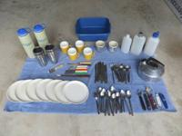 Camping supplies: bottles, cups, plates, spoons, forks,